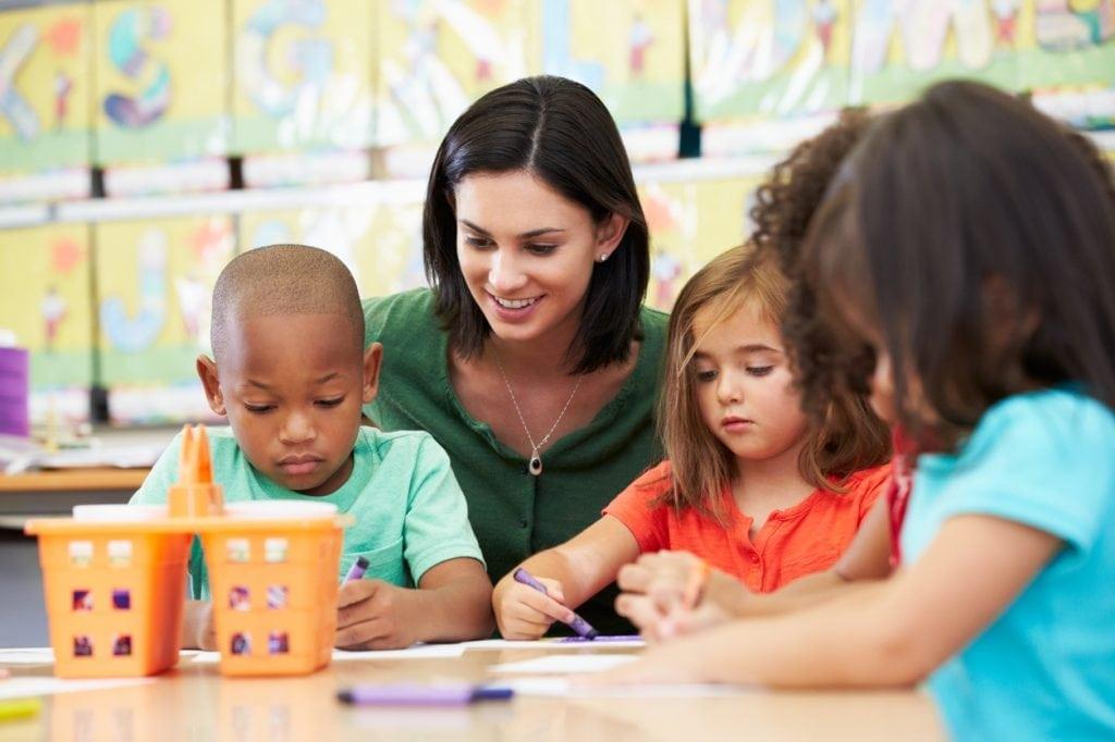 Preschool kids drawing in class