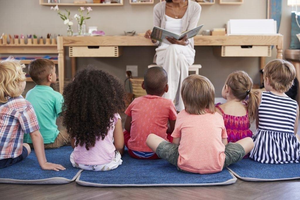 Preschool Teacher Reading to Class